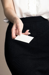 Business woman showing and handing a blank business card