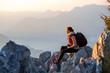 Leinwandbild Motiv Young photographer on the top of mountain