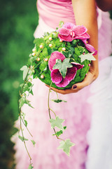 bridal bouquet with pink orchids