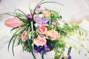 bridal bouquet with with red roses and purple flowers