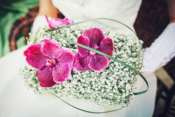 bridal bouquet with with pink orchids and white flowers