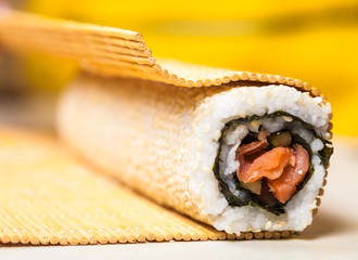 roll with red fish and sesame seeds