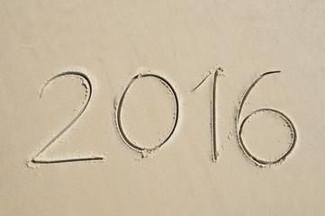 Simple 2016 Message Handwritten on Sand Beach