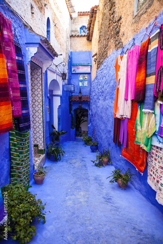 Foto op Aluminium Marokko street with colorful clothing, Chefchaouen, Morocco