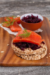 canape with grain crackers with beetroot and salmon