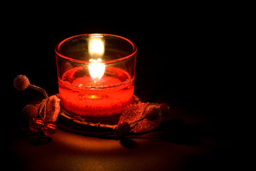 Decorative glass candle, on black background