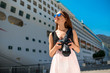 Woman tourist near the big cruise liner - 81549797