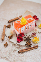 Natural soap with cinnamon and anise stars on a brown paper