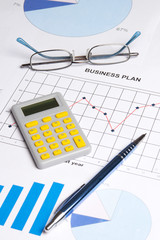 business plan with graphs, charts and calculator
