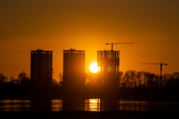 Construction site on river bank in the sunset