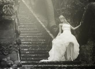 retro image of bride in fairy park in Bali