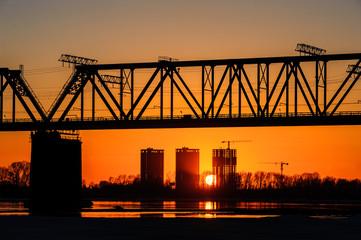 Railroad bridge and construction site on river bank