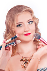 makeup process of a young pretty girl
