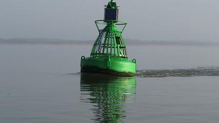 Strong tide on navigational buoy