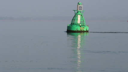 Strong tide acts on navigational buoy