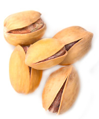 Salted pistachios on white background