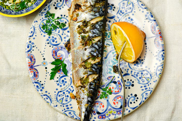 mackerel - a grill with a lemon and sauce