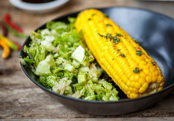 Baked corn with salad