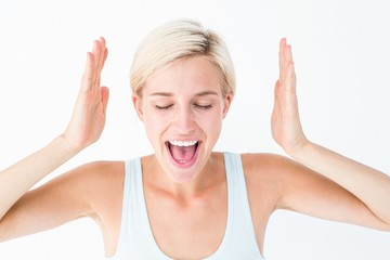 Happy blonde woman screaming with hands up