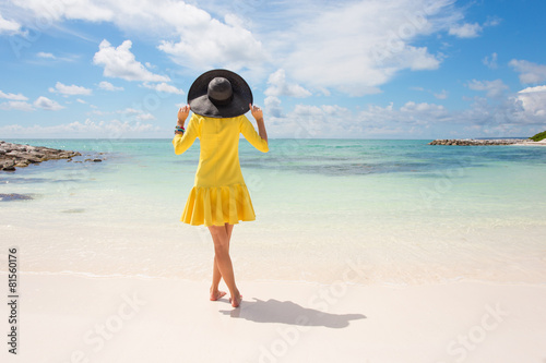 Fashionable woman in yellow dress on the beach - 81560176