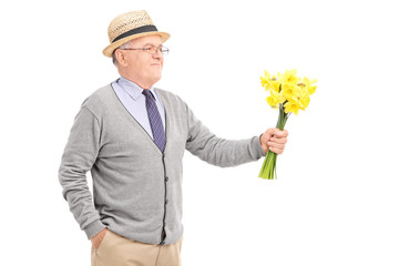 Senior gentleman holding a bunch of tulips