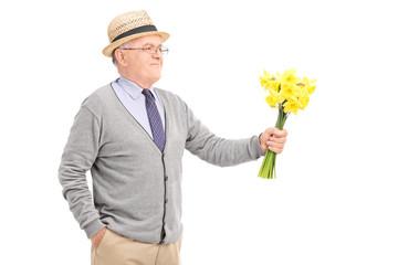 Senior gentleman holding a bunch of tulips