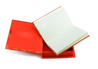 Red notebook isolated on white background.