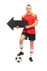 Young football player holding an arrow