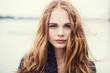 Leinwanddruck Bild - portrait of a beautiful girl on a cold windy day