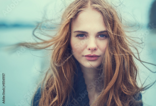portrait of a beautiful girl on a cold windy day - 81561937