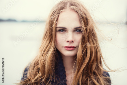 portrait of a beautiful girl on a cold windy day - 81561940
