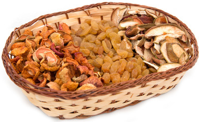a mixture of dried fruits in a basket