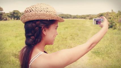 Pretty brunette taking a selfie