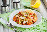 Fresh delicious pasta with fish and tomato sauce