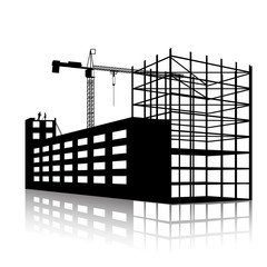 silhouette of the crane and building under construction