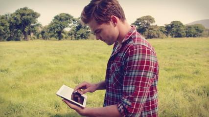 Handsome hipster using tablet