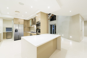 Modern white kitchen in new luxurious home