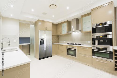 Modern white kitchen in new luxurious home - 81564521