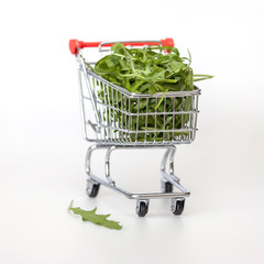 The store cart filled with arugula leaves