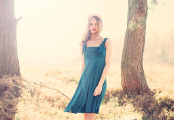 beautiful girl in a blue dress in the park in spring