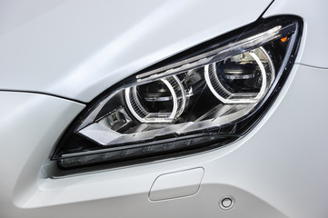 Headlight with led lamps and hood of white sport modern car