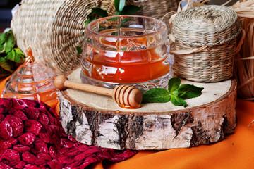 rustic honey with a spoon on birch saw cut beautiful still life