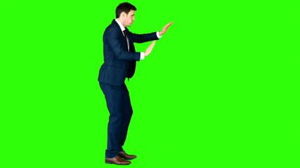 Businessman pushing something