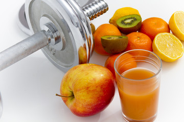 Fitness equipment and healthy food, apple, nectarines, kiwi, lem