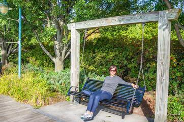 Woman Tourist Relaxing on a Swing in Burlington