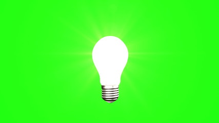 Light bulb on green background