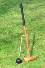 Croquet Mallet leaning against hoop