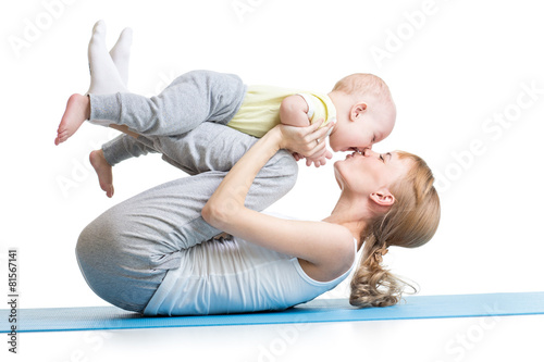 young mother does fitness exercises together with kid boy