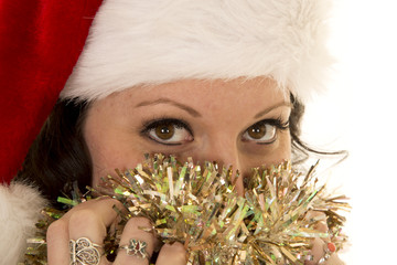 woman in Santa hat up close eyes