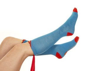 woman lgs up in blue and red socks